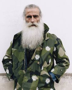 Pretty much a brilliant look. Love the mix of ideas, like the update of camouflage with embroidered flowers. This guy potentially is a total dude. But you know the whole book and cover thing.