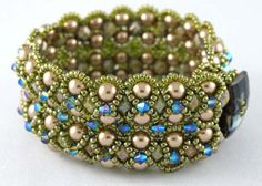 Regency Cuff pattern - That Bead Lady  Regency Cuff is a heavy wide cuff with lots of glamour! Created in double rows of Right Angle Weave with large 6mm pearls and Firepolished beads, edged and embellished with seed beads and Swarovski crystals. Pattern includes full directions with diagrams and photos