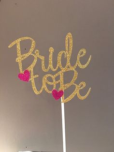 Made from gold glitter card stock paper, this cake topper will add a pop of gold to your cake! This cake topper comes in gold with hot pink