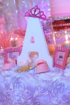 Letter decoration at a pink baby shower party! See more party planning ideas at CatchMyParty.com!