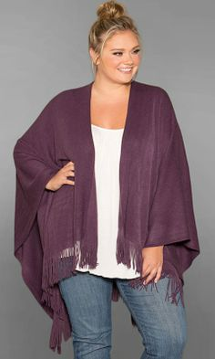 A lightweight, warm and cozy knitted plus size poncho. Over-sized with lots of room to wrap yourself in. Accented with fringe and in deep jewel-inspired shades.