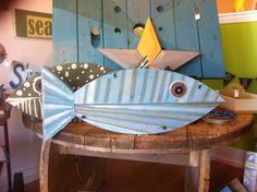 Made from recycled wood. Blue striped fish with fins.  This one swam home to West Dennis.