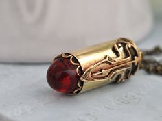 (this is my birthstone- cool!) RUBY TIP BULLET, real bullet casing necklace with vintage bullet tip ruby red glass cab Jewelry Art, Vintage Jewelry, Ivory Sandals, Steampunk Accessoires, Ruby Red Slippers, Bullet Casing, My Birthstone, Red Glass, Gifts For Mom