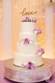 White four tier cake with a gold love sign on top | Arizona Wedding Photographers | Villa Tuscana