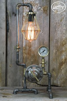 Steampunk Industrial Machine Age Lamp Enjoy a beautiful blend of brass and steel with this stunning steampunk style table lamp! Standing at 21 inches tall with a base that measures 9 inches wide and 7