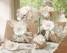 This unique rustic burlap and lace collection comes with a flower basket, guest book, pen set, garter and ring pillow.