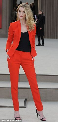 Classic look: The Transformers actress teamed her simple cut suit with a black blouse and a pair of heels
