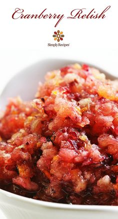 Holiday and Thanksgiving fresh Cranberry Relish—fresh cranberries ground up with apples and orange and mixed with sugar. On SimplyRecipes.com