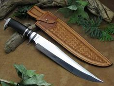 """Neilson Sub-hilt Fighter. Sweeping 12 ¼"""" blade forged from 5160 high carbon spring steel. The guard, spacer, sub-hilt and pommel are all stainless steel with a handle and spacers of African Blackwood."""