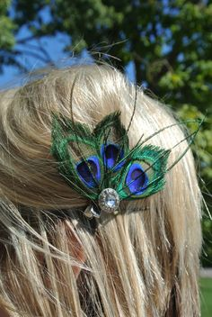 Three peacock feather hair clip. $8.20, via Etsy.