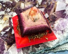 A grounding orgone generator crystal pyramid created with the intention to restore balance to your physical and energetic space. A powerful
