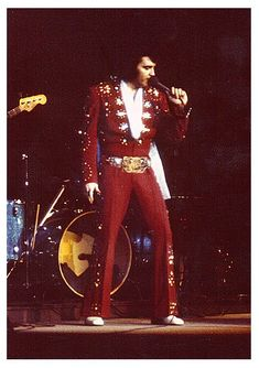 Elvis in his red jumpsuit looking red hot. April 10, 1972