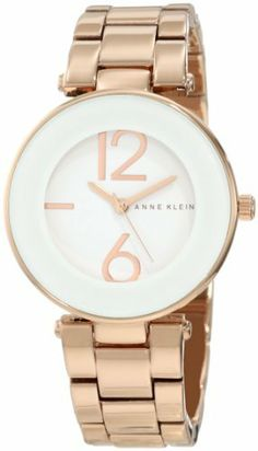 Anne Klein Women's AK/1074WTRG White Dial Rose Gold Tone Bracelet Watch Anne Klein. $58.50. Wall-to-wall mineral crystal with thick white frame. Japanese quartz movement and scratch resistant mineral crystal. Water-resistant to 30 M (99 feet). Rosegold-tone adjustable link bracelet with jewelry clasp closure and extender. Glossy white dial with stylized big arabic rosegold-tone 6 & 12 numerals and marker at 9 o'clock. Save 22% Off!