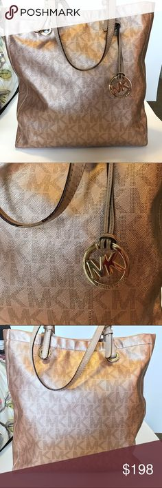 Michael Kors Rose Gold Tote Michael Kors Rose Gold Tote with MK charm. This is my absolute favorite purse ever! The color is amazing!  There is som wear inside on the lining and the straps but not noticeable. This color is very rare in the MK line. Michael Kors Bags Totes