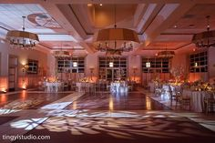It's amazing how much the right uplighting can completely transform a wedding venue! We love the way this recent couple lit up the Grand Ballroom at Stone House at Stirling Ridge! Photo by Ting Yi Studio #njweddings #weddingideas