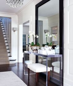 Large mirror in entryway.