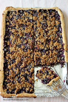 This flaky, single layer pie crust is filled with plump, juicy blueberries and topped with a crumb topping with pecans. Blueberry Slab Pie is perfect for your Summertime Parties, Father's Day, Fourth of July or take along to a Potluck.