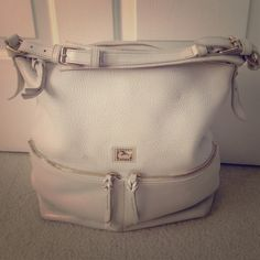 Authentic Dooney shoulder bag white/gold accents. Authentic Dooney shoulder bag white/gold accents. Feel free to ask for more info or pics. Really gorgeous bag!!! Dooney & Bourke Bags Shoulder Bags