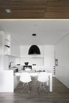 Large black pendant light above the dining area