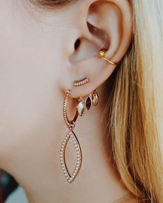 Ear game strong thanks to the Studded Marquise Hoops + Marquise Dangle Studs in…