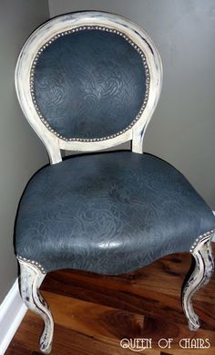 amazing anthro knock off! --chalk paint on fabric, car wax on top. comes off like tooled leather! Love it. from the Queen of Chairs blog.