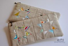 My {sew tiny} pieces have transformed into zippered pouches. The wonky star pouches have been...