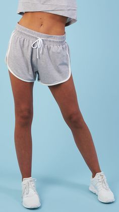 In a classic retro fit, the Retro Shorts are high-waisted and figure-hugging. Coming soon in Light Grey Marl.