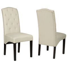 The crown back Alessa chair is effortlessly subtle in its modern royalty design. This dining chair is upholstered in a beige linen fabric and adorned with brass nailhead trim