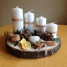 Cheap and Easy Christmas Centerpiece Ideas that you can Make in a Jiff - Hike n Dip Thinking about easy and cheap christmas centerpiece ideas that you can do by yourself? Look here for some of the easiest Christmas centerpiece ideas. Christmas Advent Wreath, Christmas Candle Decorations, Cheap Christmas, Noel Christmas, Christmas Candles, Modern Christmas, Rustic Christmas, Simple Christmas, Natural Christmas