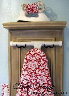 """We've added a new """"decoration"""" to our laundry room. We recycled a cabinet door into an ironing station. Come see what we did. :)"""