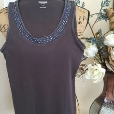 Express top with bling Express top. Goes with anything and can be worn alone, under sweater or jacket. Great top that goes from casual to dressy. Express Tops Tank Tops