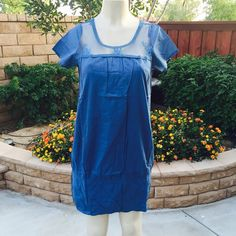Blue shift dress Beautiful blue dress with lace neckline . 100% cotton . Measurements lying flat . Medium - Bust :17  waist : 19 length: 33 Large - Bust :18  waist : 21 length: 33 . Dresses