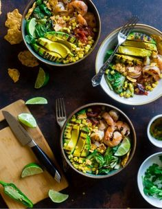 Honey Lime Grilled Avocado Shrimp Nacho Bowls - These smoky-sweet bowls have glazed honey lime grilled avocado, spicy shrimp. tomato and corn! Top them with gluten free nacho chips for a healthy, summer meal that's packed with flavor! Fresh Fish Recipes, Best Seafood Recipes, Healthiest Seafood, Cheesy Recipes, Entree Recipes, Cooking Recipes, Shrimp Nachos, Chicken Nachos Recipe, Buttery Garlic Shrimp