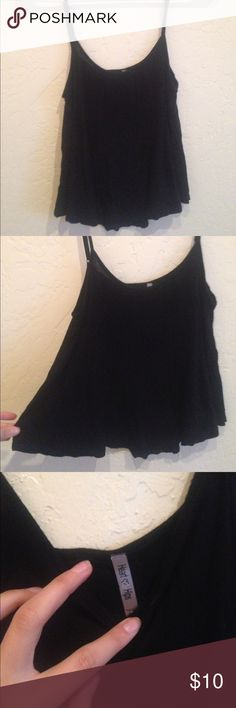 Flowy black tank No condition issues, super cute I just don't wear it. Listed as brandy for visibility. Brandy Melville Tops