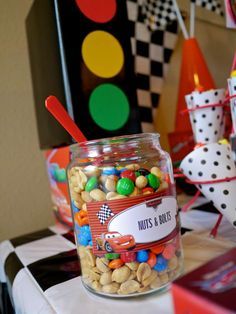 lots of themed food for a Cars party Idea dip bugles in orange
