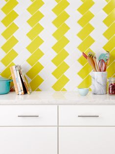 Yellow + white stripe zig zag subway tile backsplash pattern