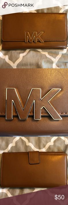 Michael Kors Wallet This is one of my favorite wallets! It is not too small but not too big. It fits everything you need in one place! This wallet is lightly used. Leather is in good condition and no scratching on the MK that I could tell. I will be listing a MK purse shortly that I used with this wallet. They were a great match! MICHAEL Michael Kors Bags Wallets