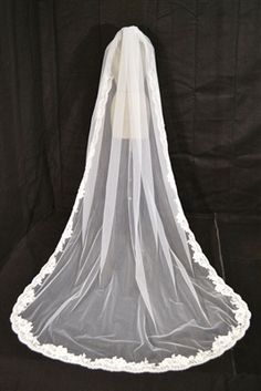 One tier lace cathedral length bridal veil with beading, crystal accents and rhinestone details.