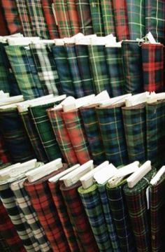 Is this what Tartan Heaven looks like?) Actually it's bolts of fabric from the MacNaughtons Emporium in Pitlochry, Scotland. Wish I knew my clans tartan. Motif Tartan, Tartan Fabric, Scottish Plaid, Scottish Tartans, Harris Tweed, Textiles, Pitlochry Scotland, Tartan Material, Flannel Material
