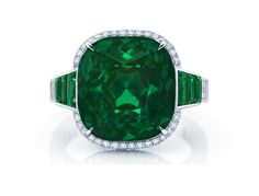 Martin Katz Cushion shaped emerald accented with 6 channel set baguette emeralds, set in platinum.