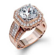 Silvia Collection - This gorgeous 18K rose gold engagement ring is comprised of .87ctw round white Diamonds and .70ctw princess cut white Diamonds.  - NR268