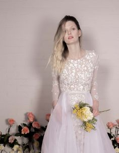 Wild Daisy Gown with hand-cut organza petals, leather sequins, embroidered with silk thread on soft tulle styled with 'Organza Overskirt'. Couture Dresses, Bridal Dresses, Flower Girl Dresses, Wedding Cape, Wedding Gowns, Hermione, Tulle, Wedding Dress With Pockets, Wedding Flower Inspiration