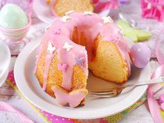 A recipe for Pink Lemonade Pound Cake made with lemon cake mix, lemon pudding mix, eggs, vegetable oil, milk, frozen pink lemonade