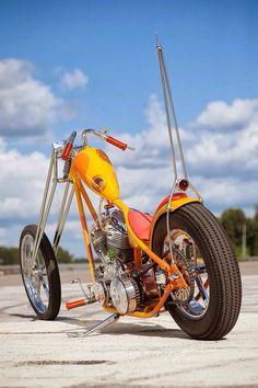 Custom chopper, orange. Big sissy bar - repined by #VikingBags