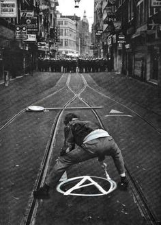 """How I totally painted an anarchy symbol on the street... right in front of about 50 riot cops... """