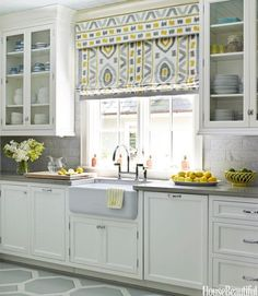 Choosing a color palette for a kitchen remodel? Here's an idea - find a fabric that you absolutely adore like the ikat pattern used in this kitchen. Use the pattern as a guide for choosing complimentary accents, fixtures, etc. for the space. The best part is, when you are making these decisions, you can take the pattern with you to help ease the process.