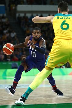 #RIO2016 Kyrie Irving of United States moves the ball against Andrew Bogut of Australia on Day 5 of the Rio 2016 Olympic Games at Carioca Arena 1 on August 10...