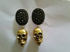 Check out this item in my Etsy shop https://www.etsy.com/listing/252056358/skull-earrings-with-pave-spinel-sterling
