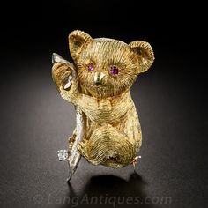 Need a hug? That's just what this furry Australian friend has gone out on a limb for. Superbly crafted in rich and substantial two-tone 18K gold with bright ruby eyes and a single diamond leaf, he's waiting to let go of his eucalyptus branch and come to you. 1 1/2 inches high.   $2,250.00