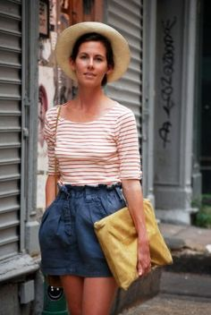Claire Cottrell sporting a Clare Vivier yellow laptop clutch (in stock at the shop - yay!)